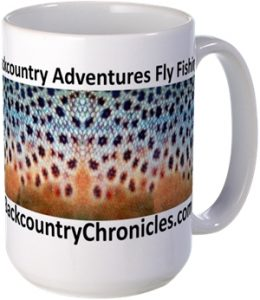 backcountry adventures fly fishing logo with brown trout skin