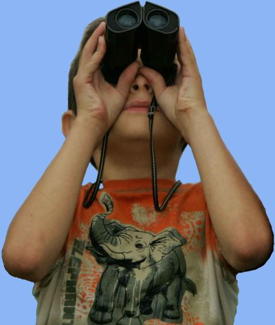 small boy using binoculars