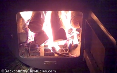 fire in wall tent stove