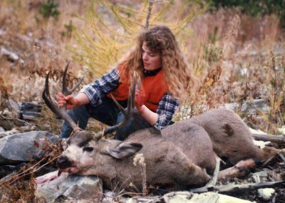 woman with mule deer buck