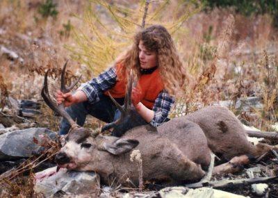 woman with mule deer buck
