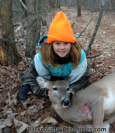 young hunter with white-tailed deer